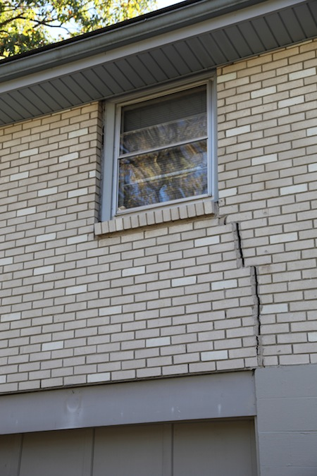 Vertical cracks can be a sign of foundation settlement.