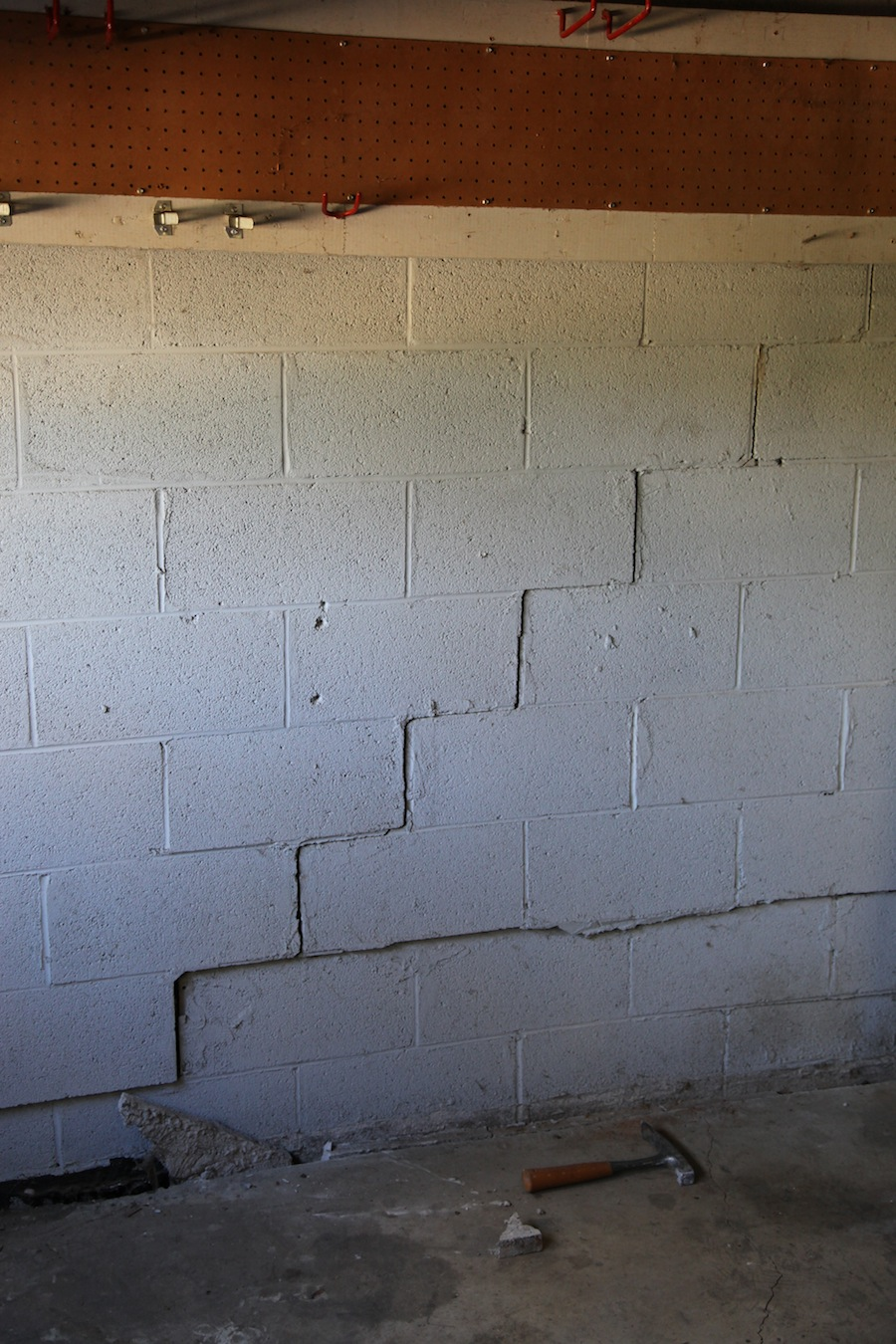 Stair Step cracks are seen here in this basement wall, which indicates the foundation is settling.